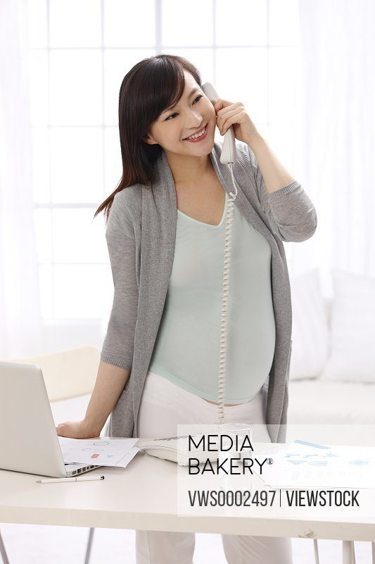 Pregnant woman calling by phone