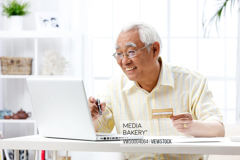 An old man use a laptop