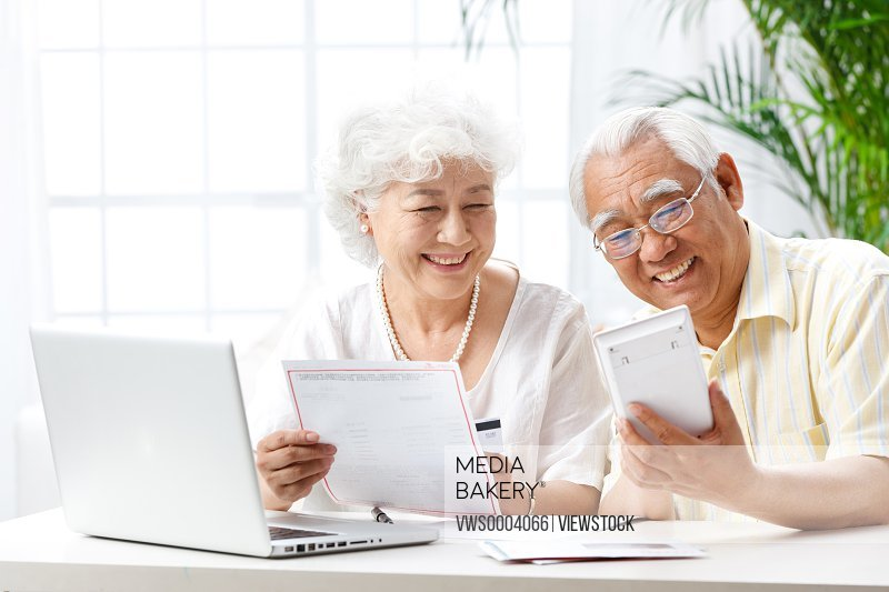 Old couple read reports
