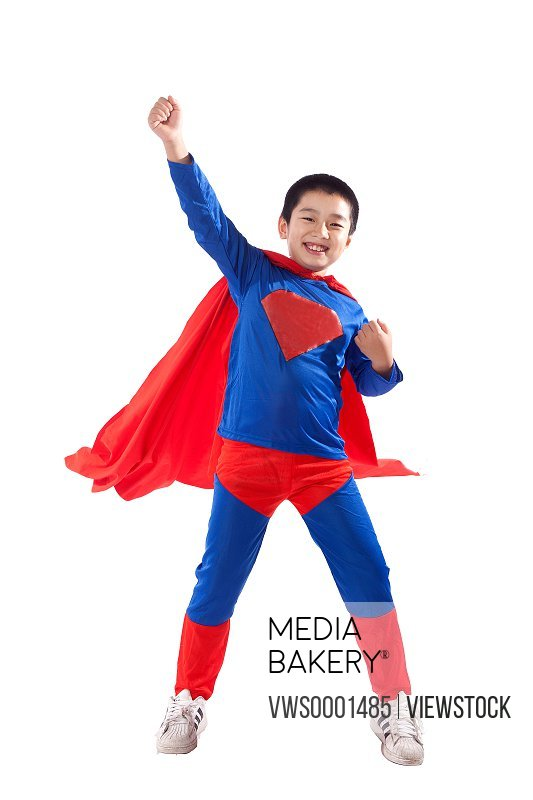 A boy in superman outfit
