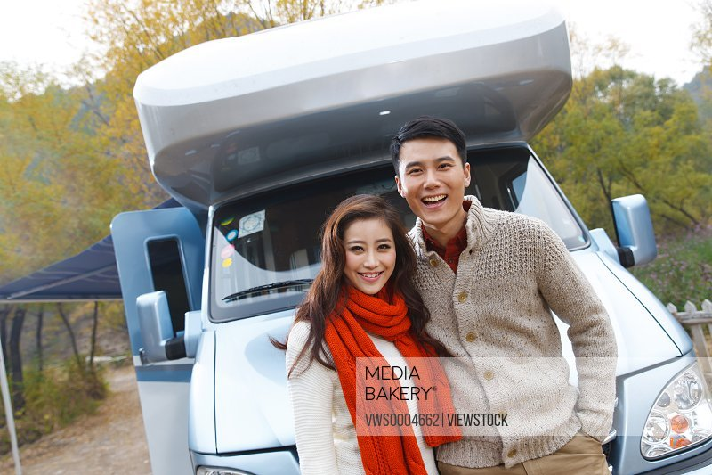 Couple in front of a motor home