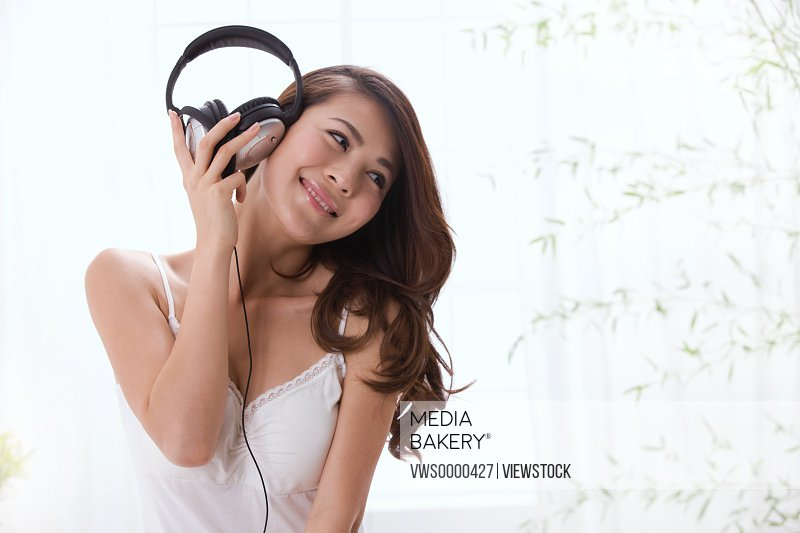 Young lady listening to music