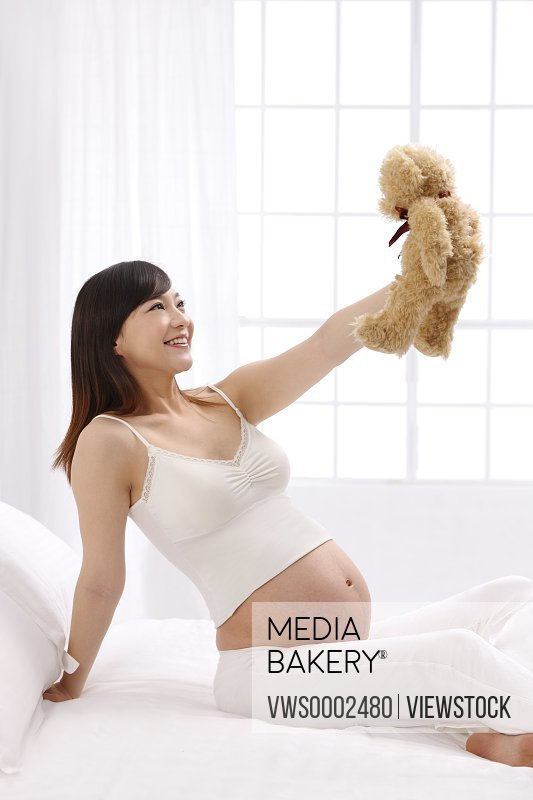 Pregnant woman with Teddy bear