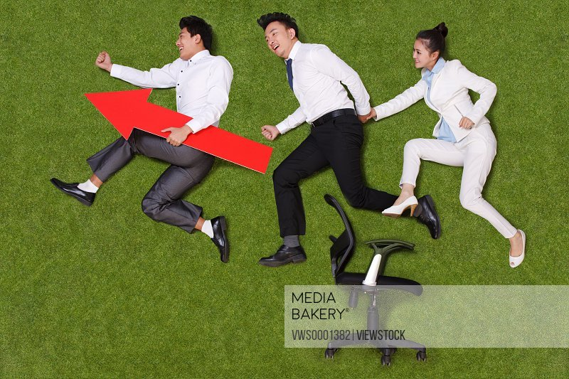 Young business people concept image on grass