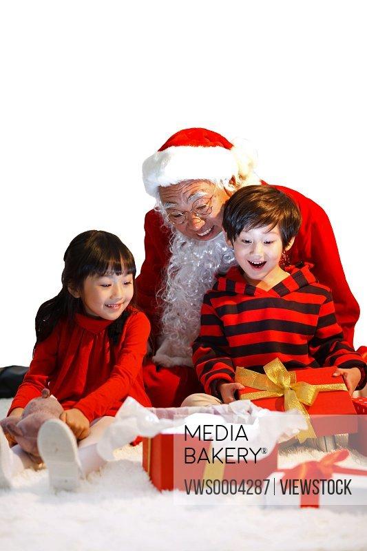 Santa Claus and young kids