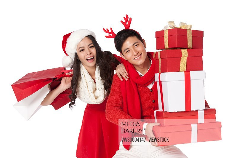 Young couple holding a Christmas gift