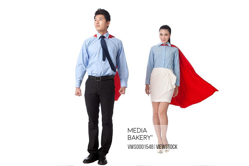 Young man and young woman in superman outfit