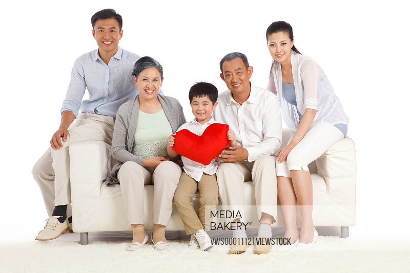 Whole family sitting in sofa