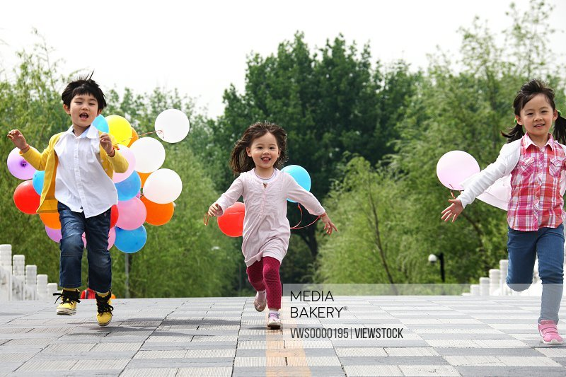Oriental children playing outdoors