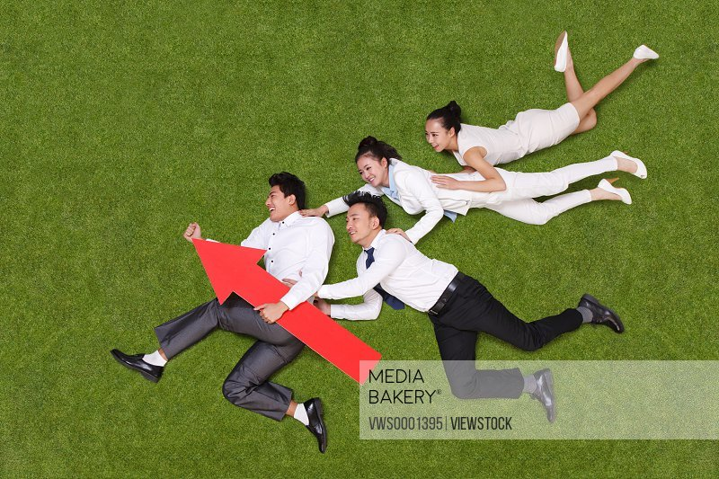 young business people with red arrow