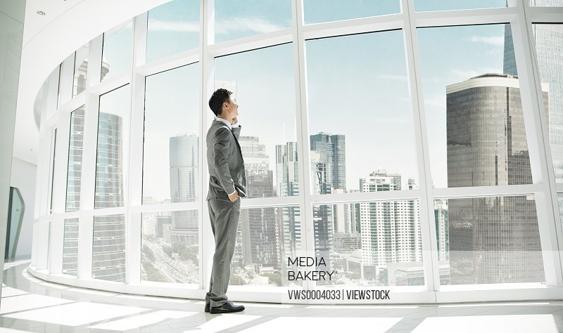 Young business man in business building