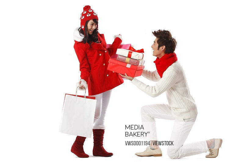 Young couple holding Christmas gift