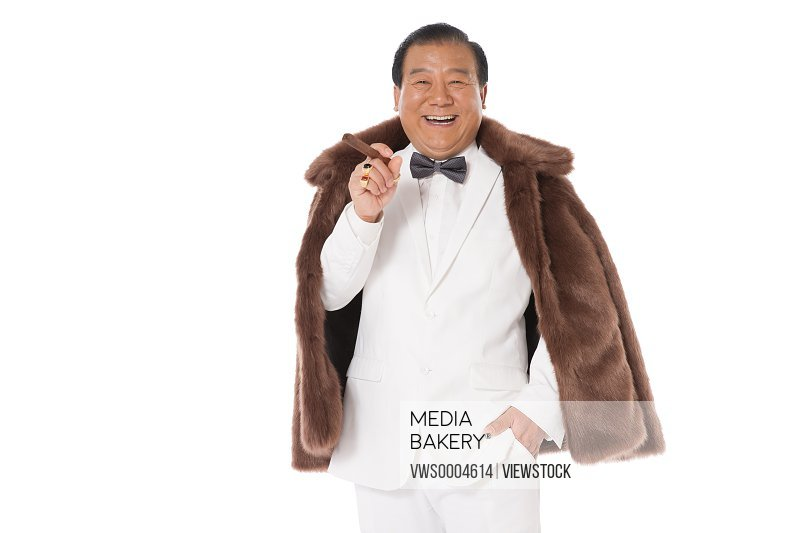Successful man holding a cigar