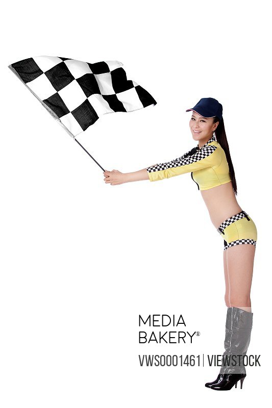 Young woman holding checkered flag