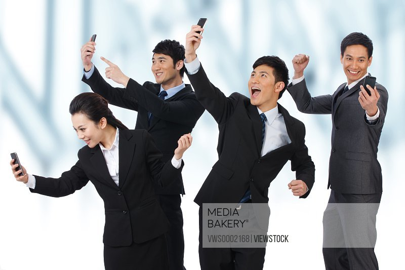 Business people using cell phones