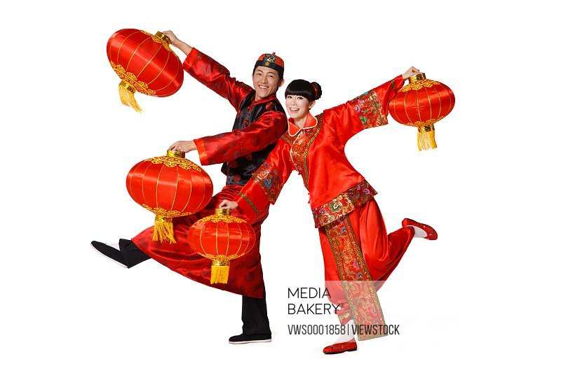 Young couple celebrating Chinese New Year with lanterns
