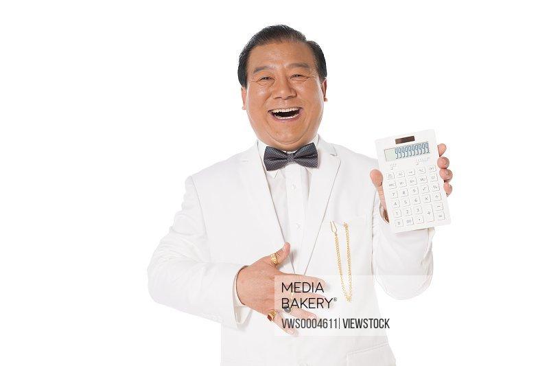 Successful man holding a calculator