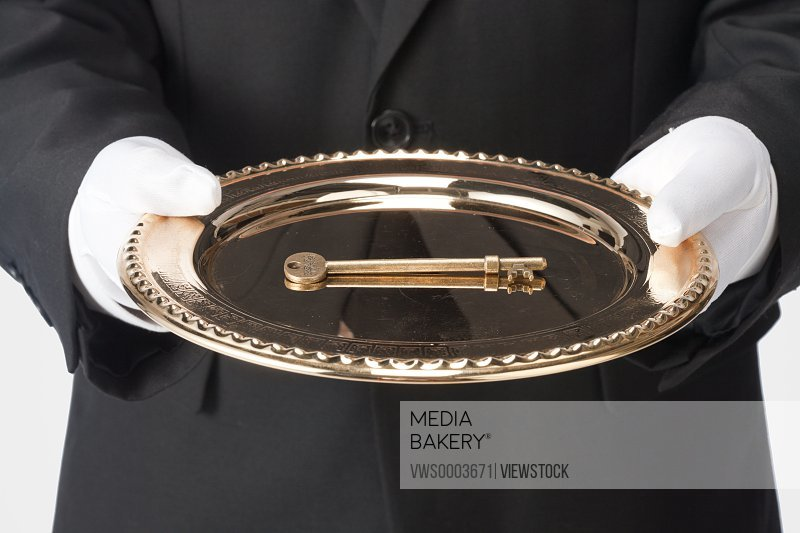 A golden key in tray