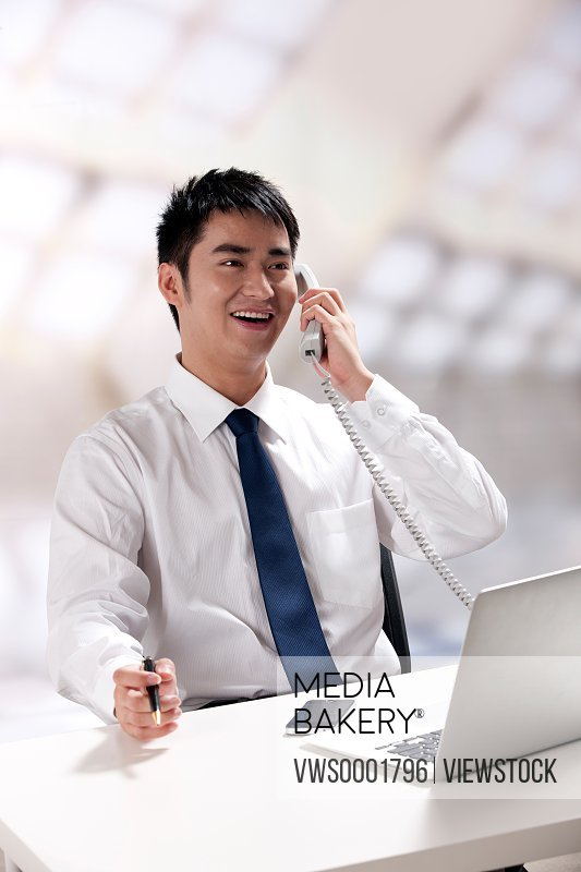 Young businessman talking on the phone
