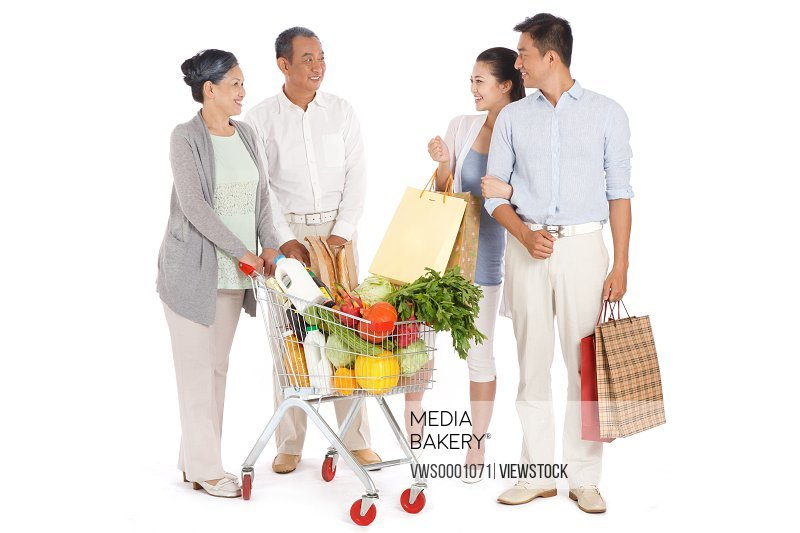 Old couple and young couple shopping with shopping cart