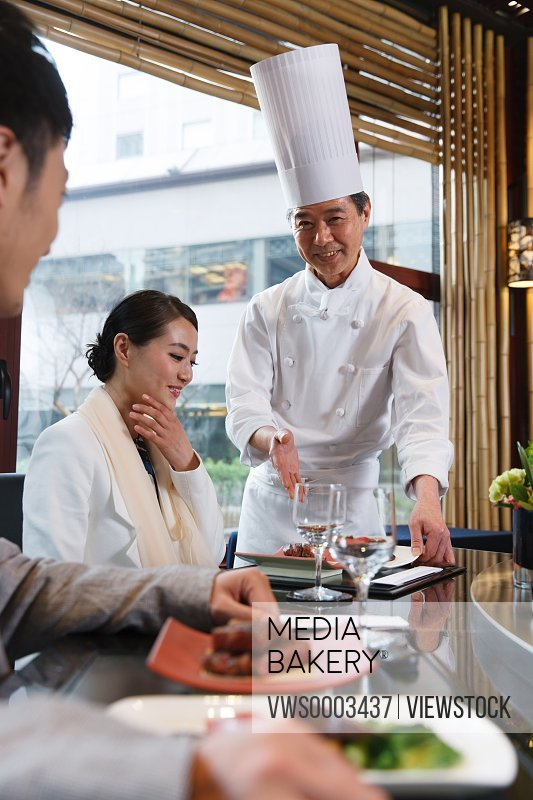 Chef with customer