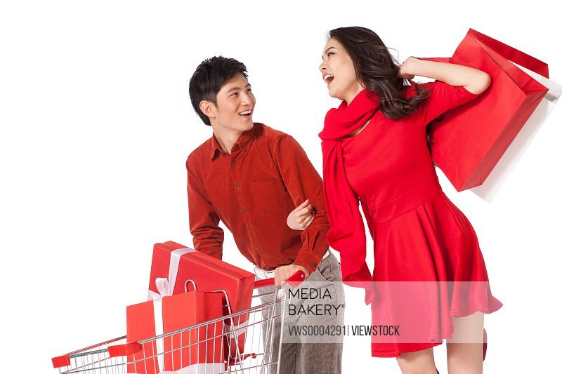 Young couple with a shopping cart