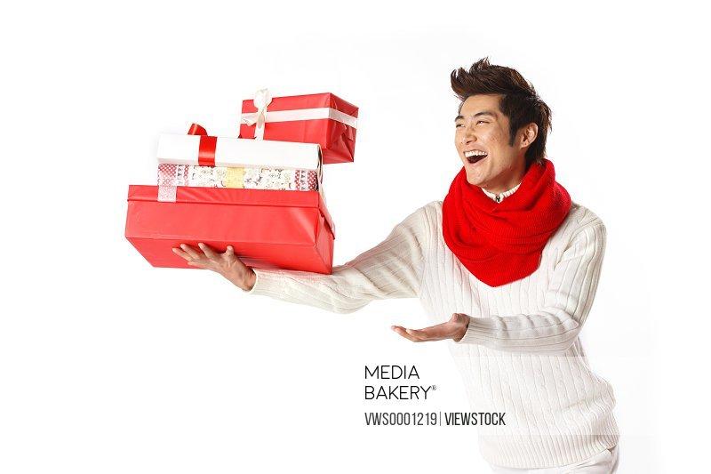 Young man holding Christmas gift
