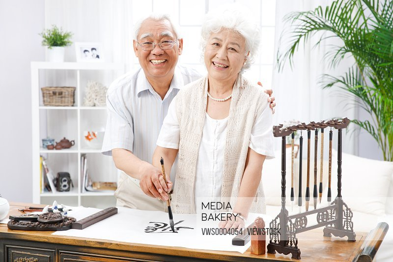 Old couple practise calligraphy