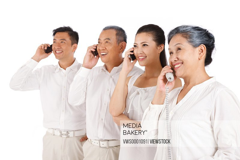 Old couple and young couple making phone call
