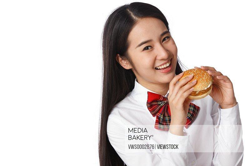 Student girl eating hamburger