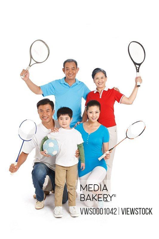 Whole family holding racket