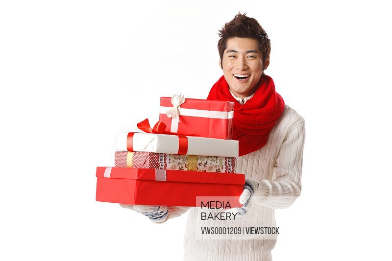 Young man holding Christmas gift