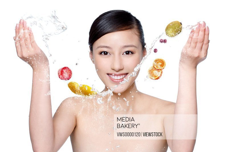 Digital composite of orient woman makeup,water and fruits