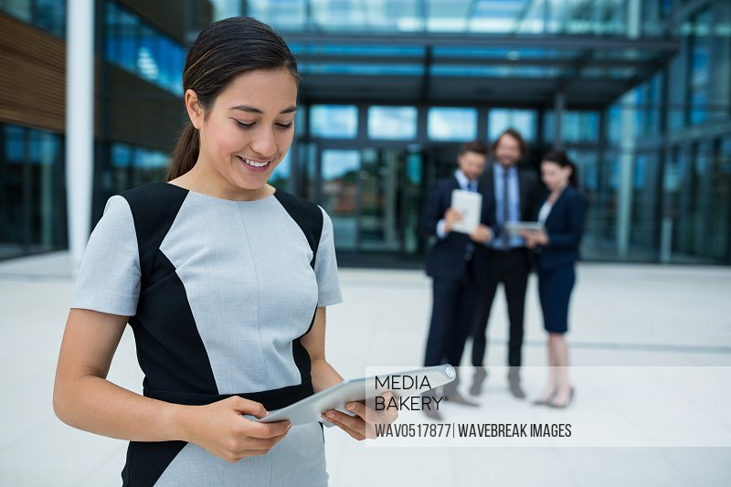 Businesswoman holding digital tablet
