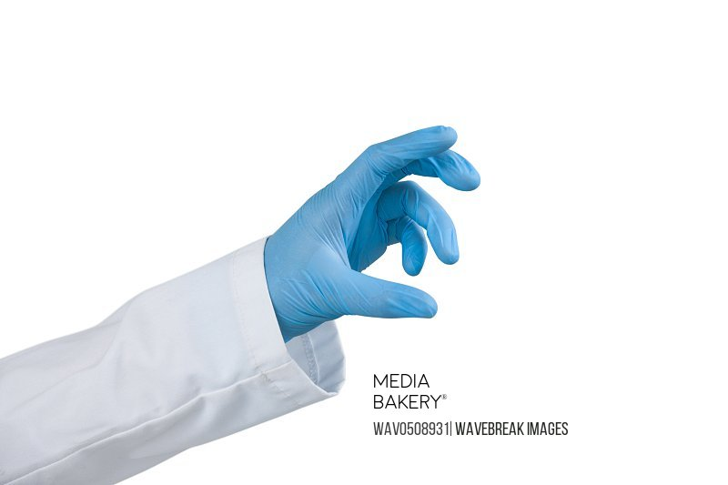 Hand of female scientist conducting an experiment