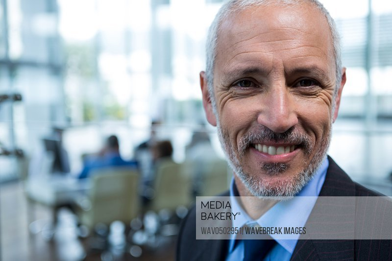 Close-up of smiling businessman in office