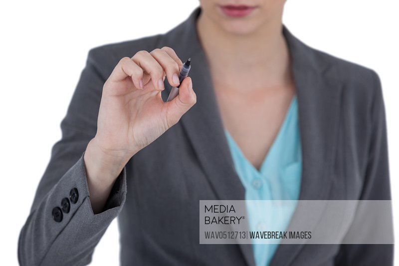 Mid section of businesswoman using digital screen against white background