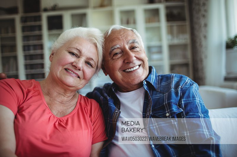 Portrait of senior couple sitting together at home