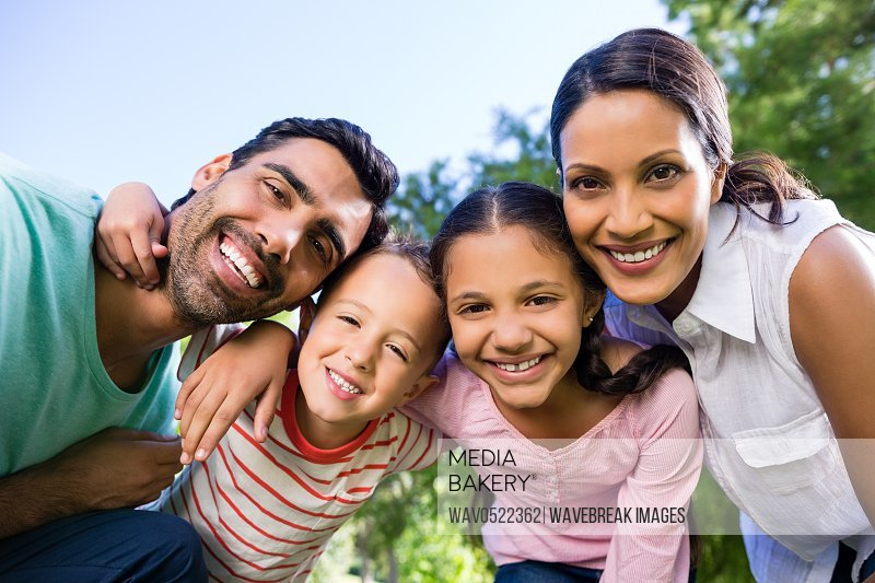 Portrait of smiling family in park
