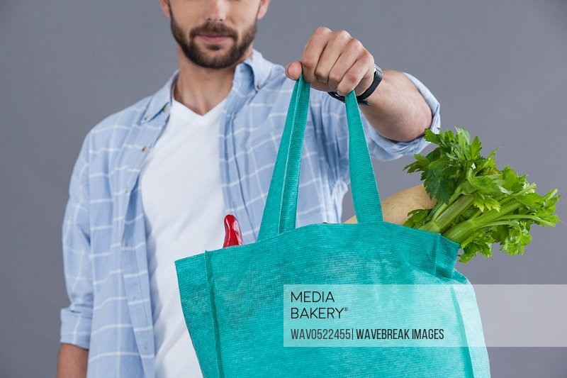 Man holding a grocery bag