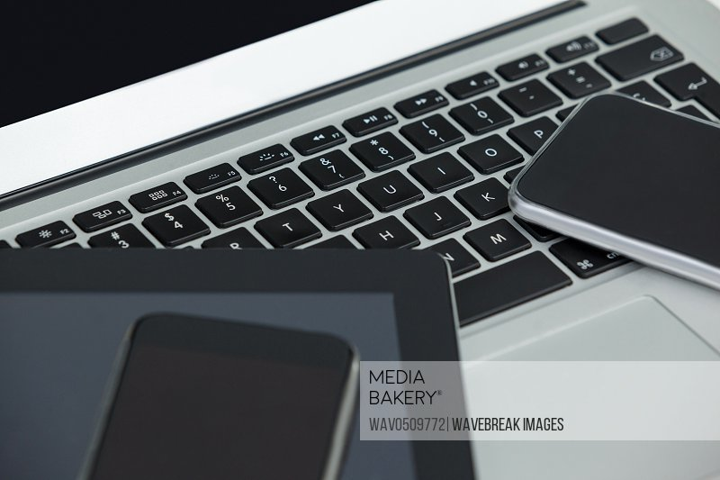 Close-up of laptop, digital tablet and mobile phones