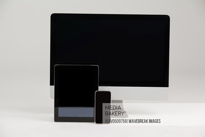 Close-up of computer, tablet and mobile phone on white background