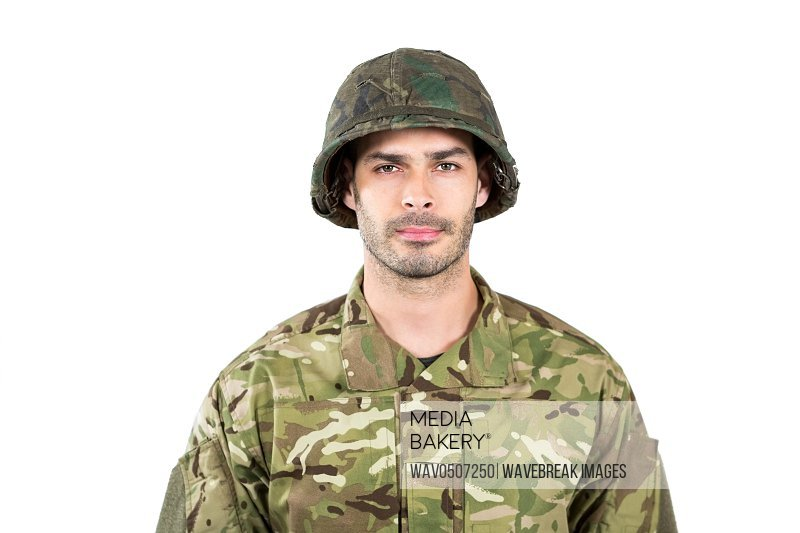 Portrait of confident soldier standing on white background