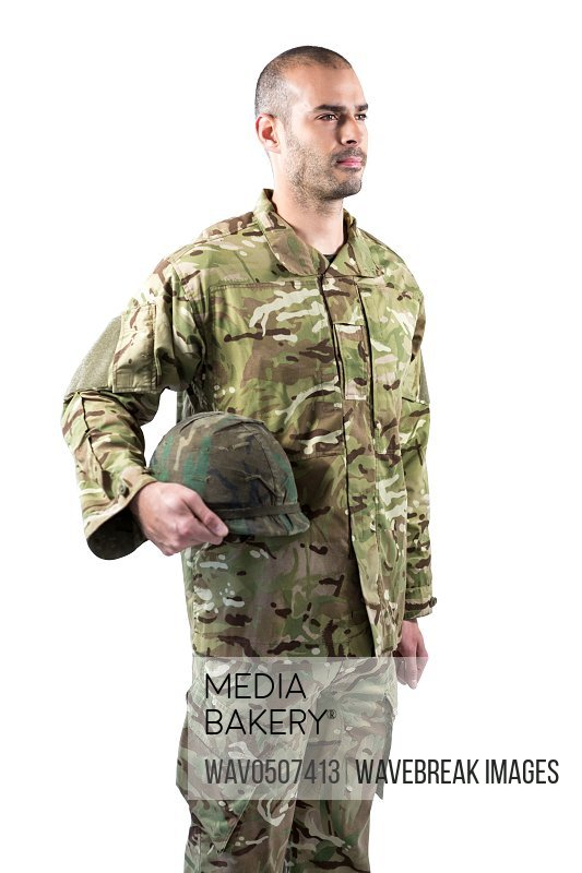 Confident soldier standing with a helmet against white background
