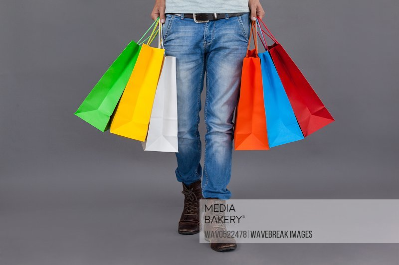 Man holding colourful shopping bags