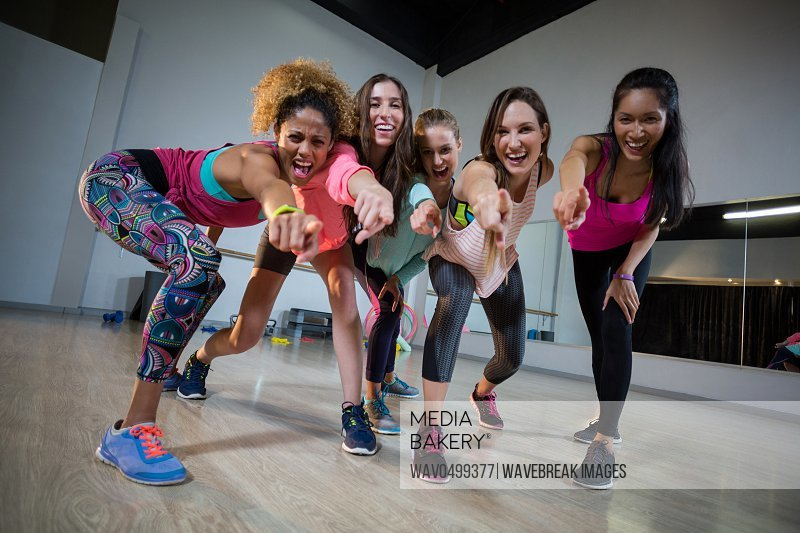 Group of women excited while exercising in gym