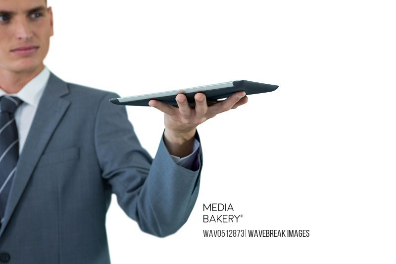 Businessman holding digital tablet against white background