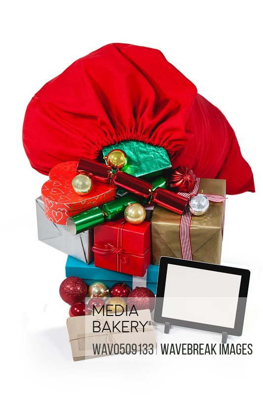 Santa bag filled with surprised gifts and digital tablet