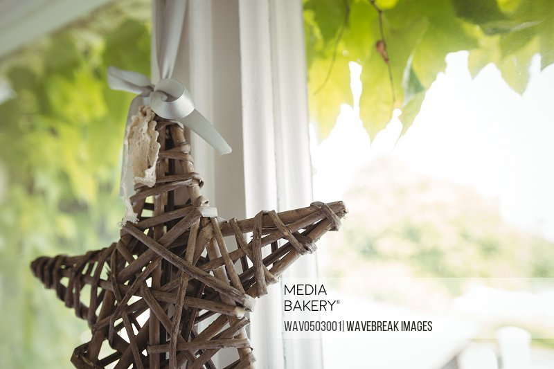 Wicker star hanging on a window at home