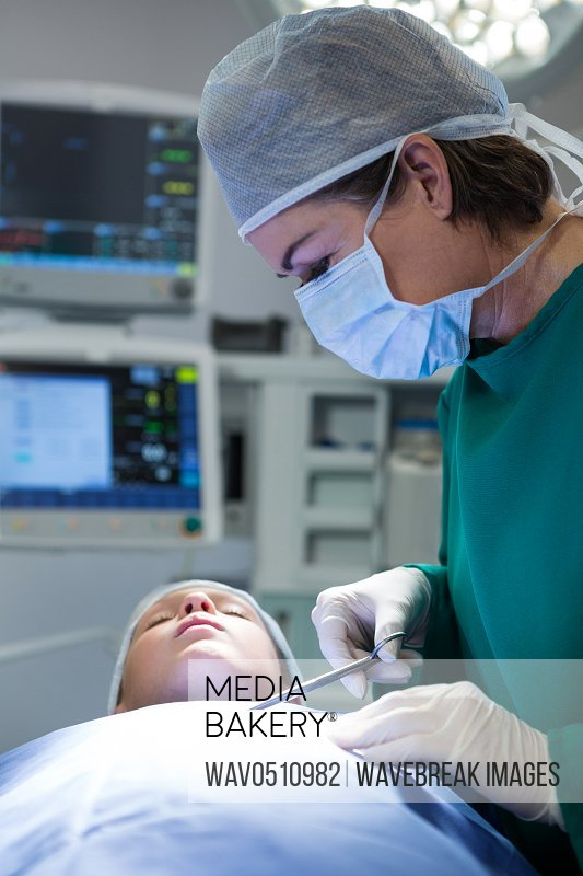 Surgeon operating patient in operation theater